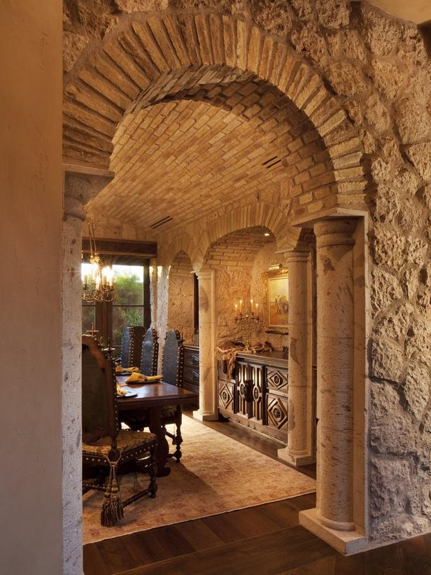 Stone Brick Archway Leading Into Tuscan Dining Room