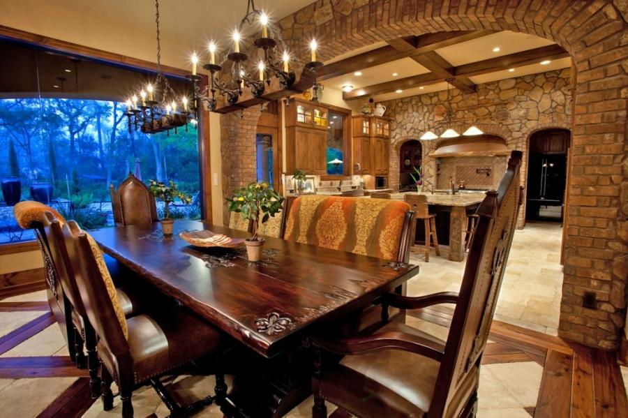 The design of this upscale Tuscan dining room incorporates a wood...