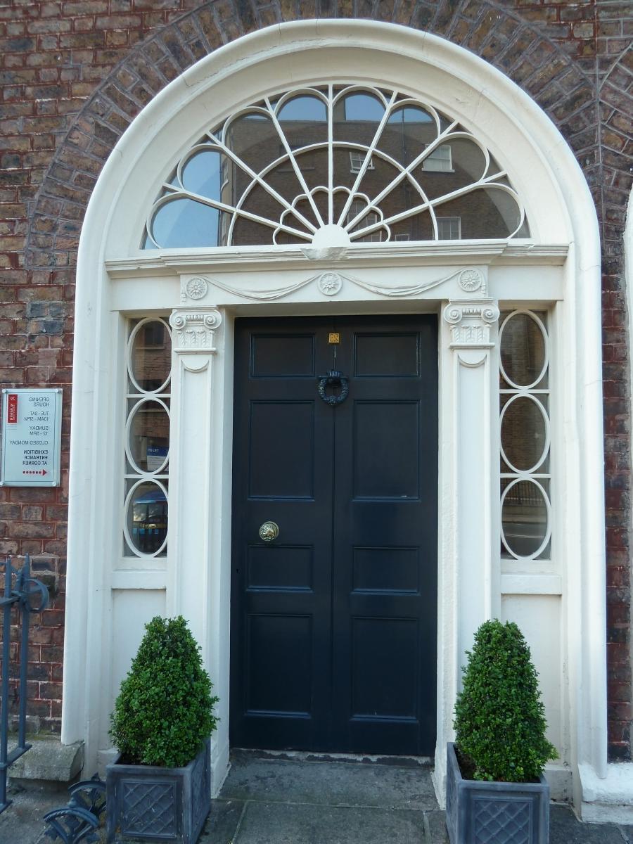 White House Brown Roof Black Door