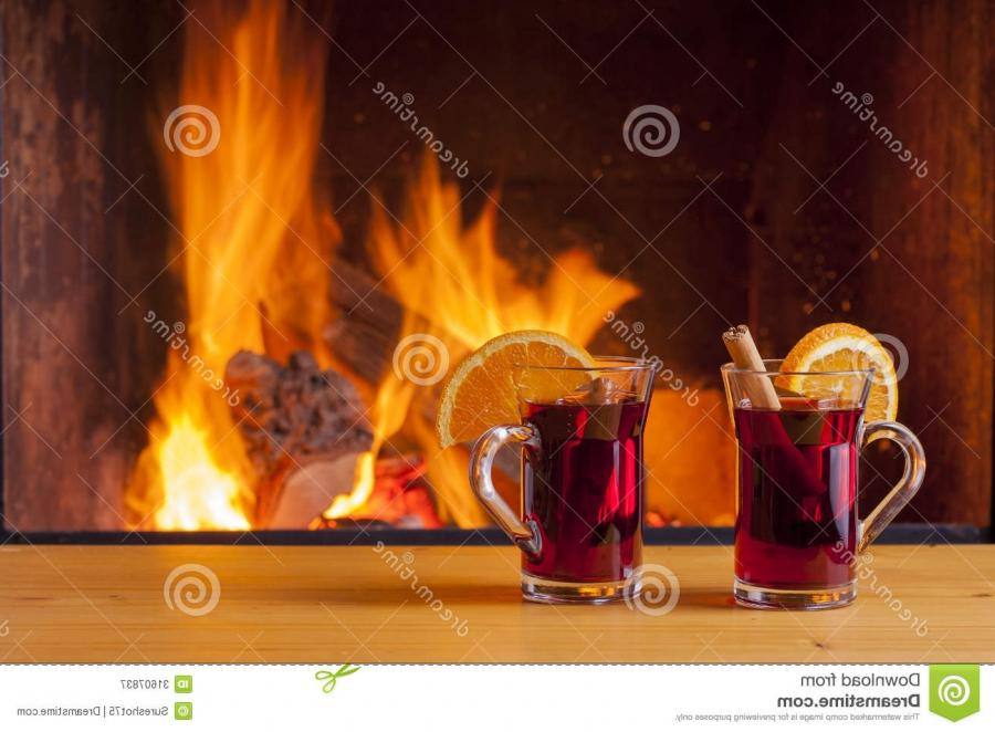 Mulled wine at cozy fireplace in winter