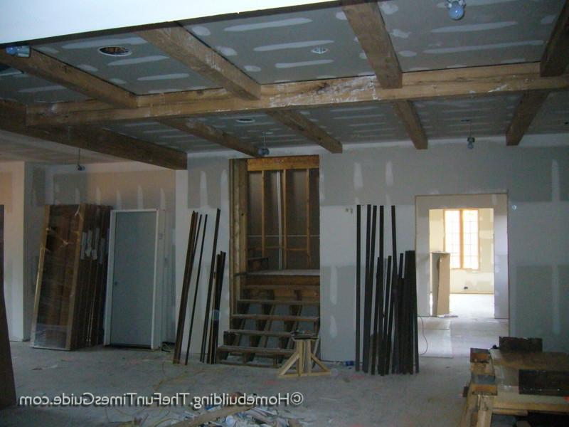An exposed beam ceiling consisting of hand-hewn, solid white oak...