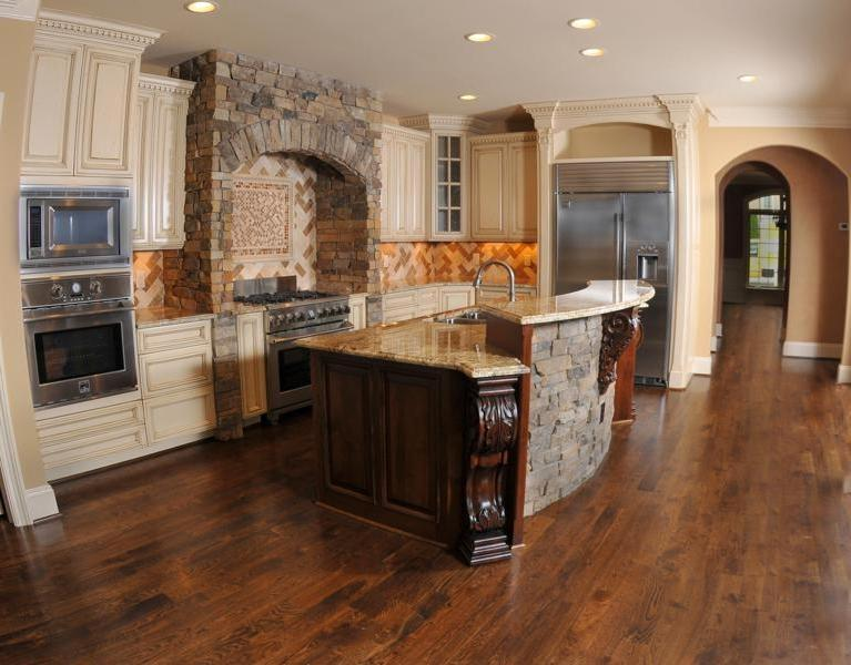generous kitchen space with finished hardwood floors