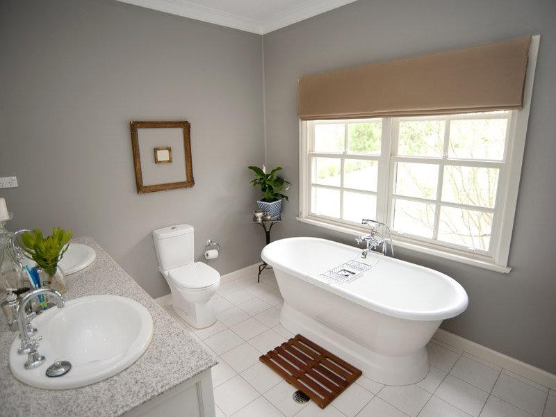 Classic bathroom design with freestanding bath using ceramic -...