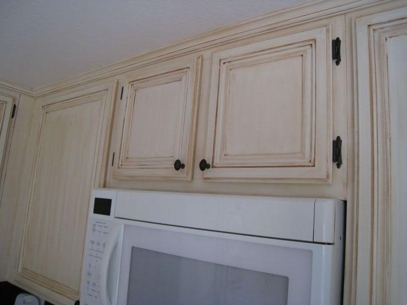 Antique glazed cabinets photos for Antique white kitchen cabinets with chocolate glaze