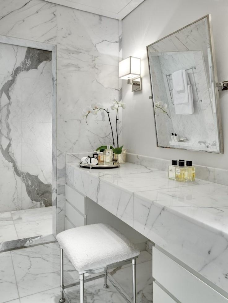 Exquisite bathroom appliances and retro touches make marble shine...