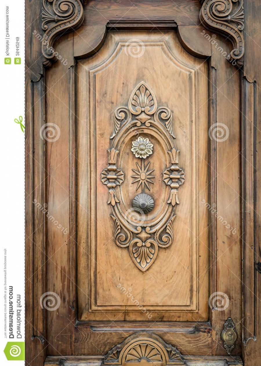 Old Door Of Wood With Patterns Carved On It. Royalty Free Stock...