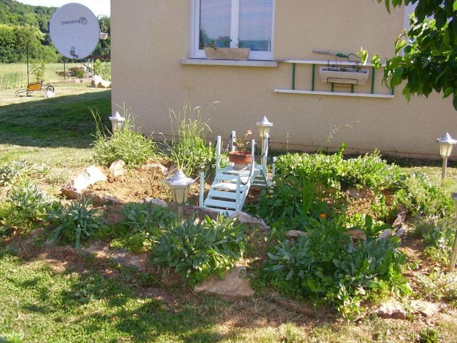 Decoration exterieure jardin photos for Deco jardin devant maison