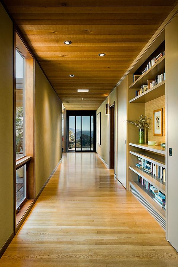 Hallway with stylish wall-enclosed bookshelf