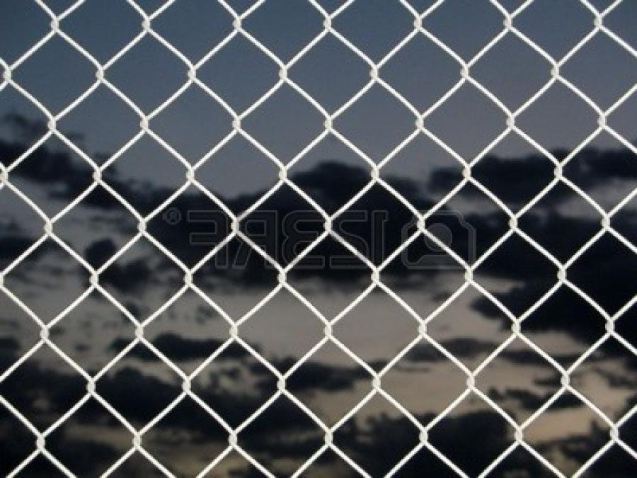 Chain link fence with dark sky