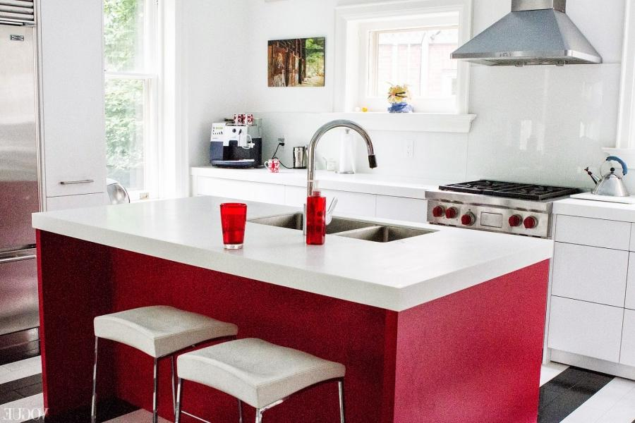 Black and white stripe floors and a red kitchen island make bold...