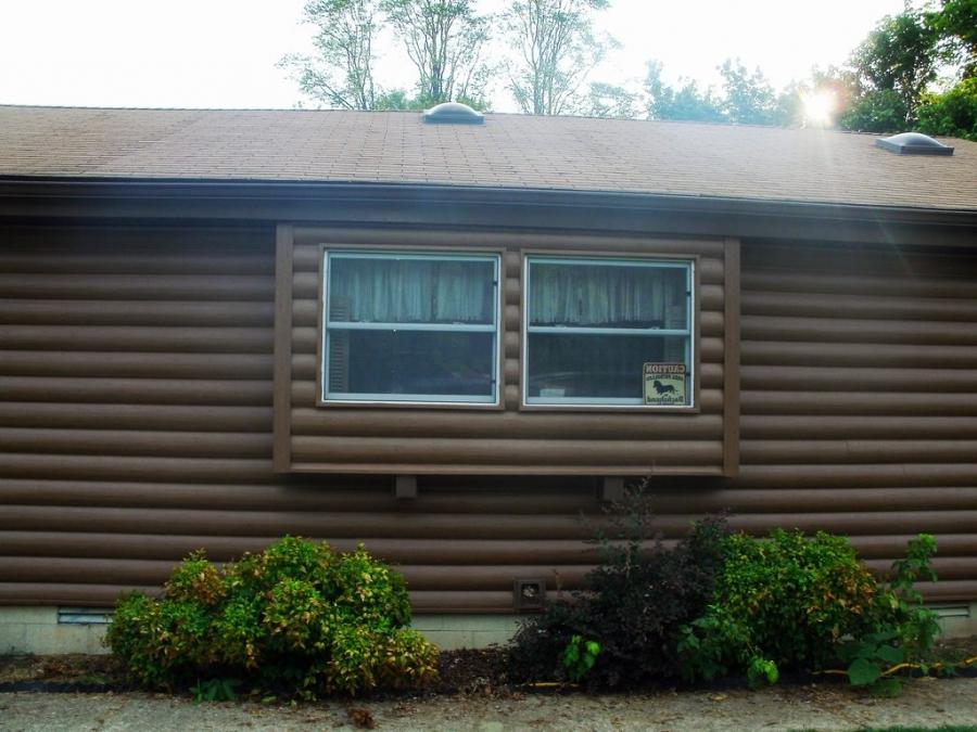 Log cabin siding photo gallery 100 mountaineer log cabins for Log vinyl siding pictures