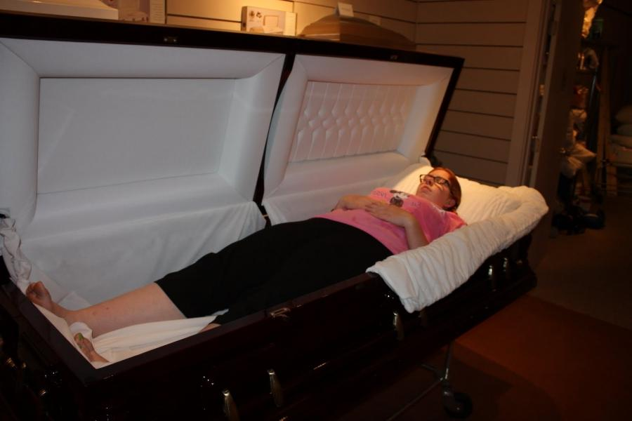 People in casket photo for Home source com