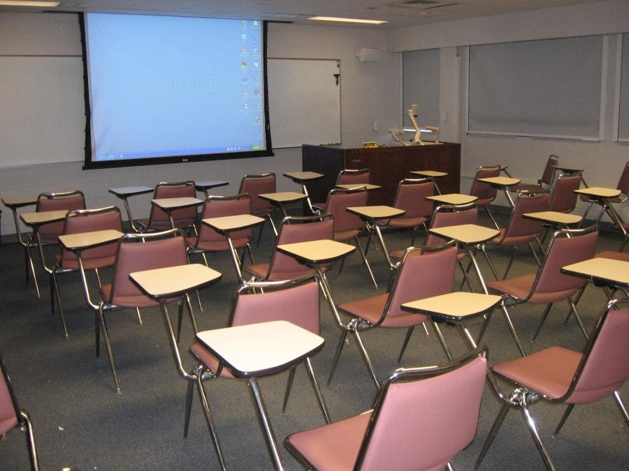 207, Mid-size classroom with built-in AV equipment. No conference...