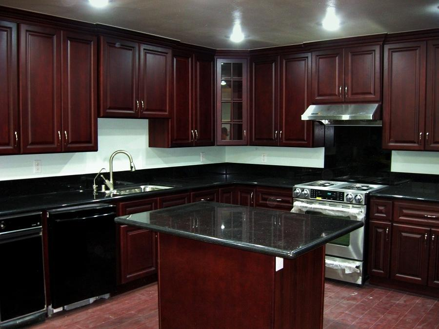 Cherry cabinets black granite photos for Cherry kitchen cabinets with black granite