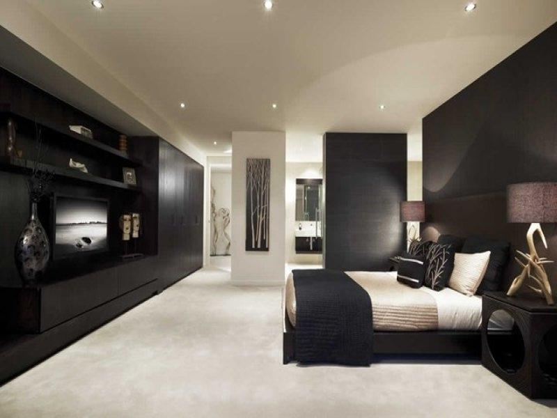 Modern bedroom design idea with wood panelling  built-in shelving...