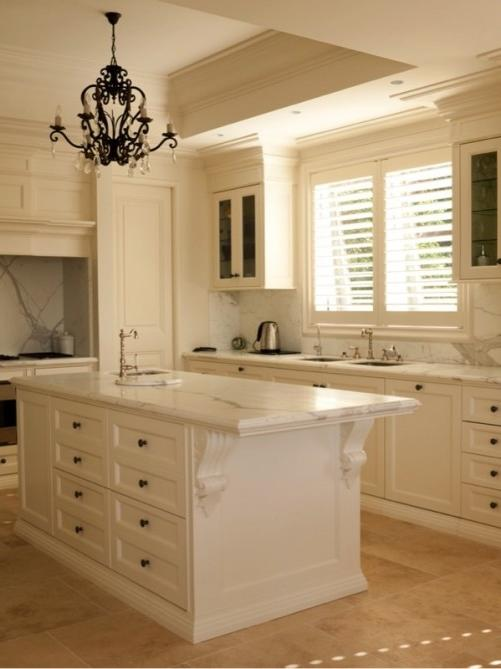 This classic French kitchen with a subtle antique finish and...