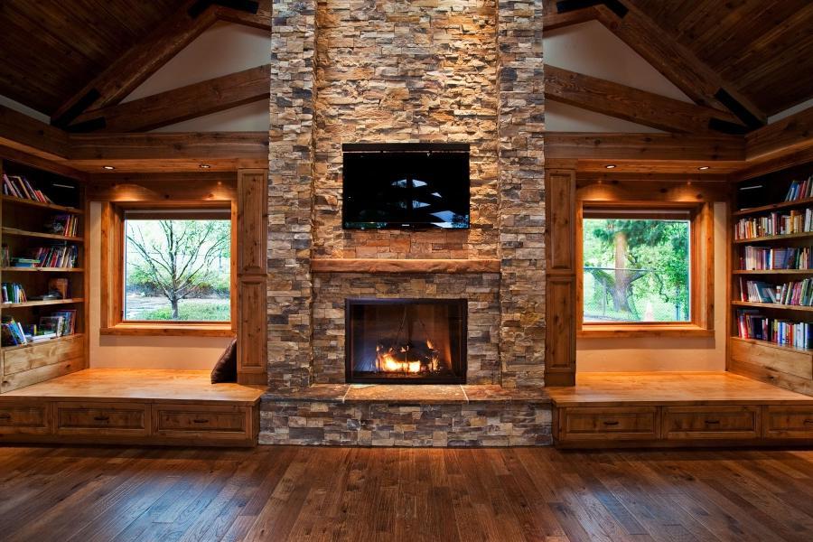 Log cabins photos interiors for Log home fireplaces