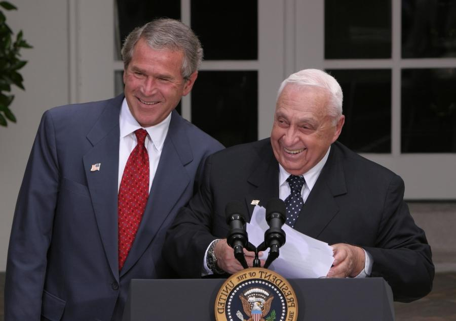 ... Bush and Israeli Prime Minister Ariel Sharon laugh together...