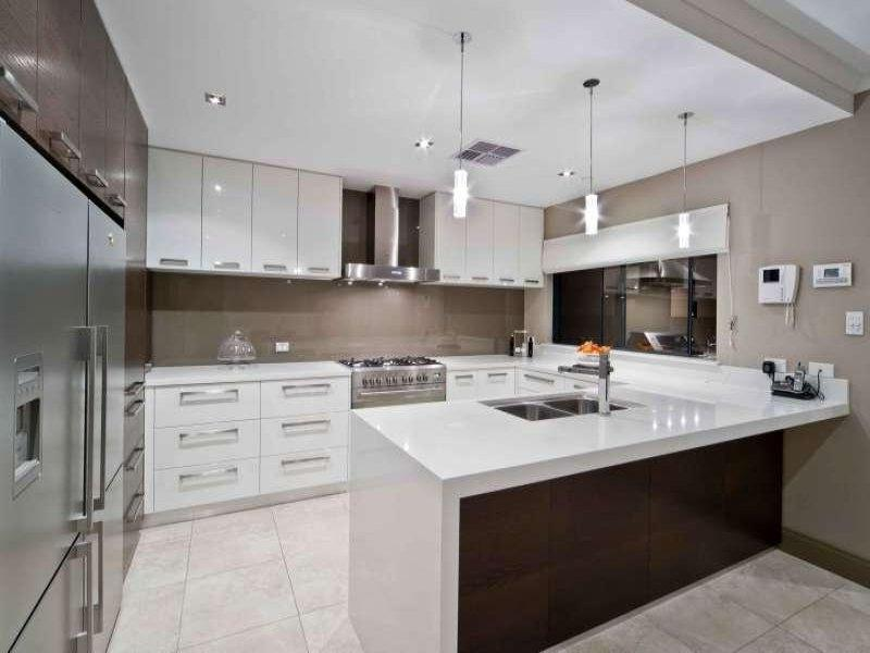 Modern u-shaped kitchen design using tiles - Kitchen Photo...