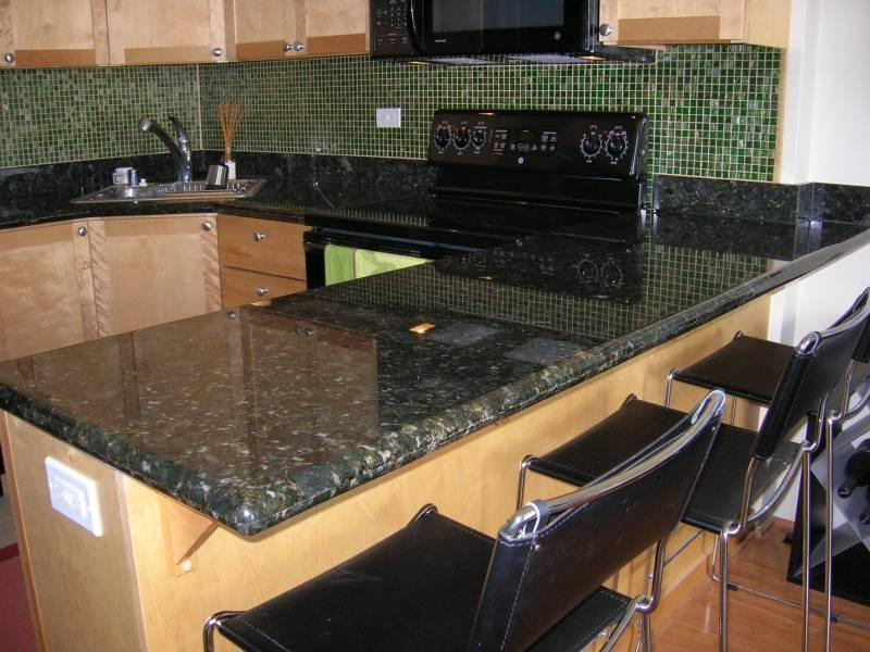 Backsplash tile with black granite countertops