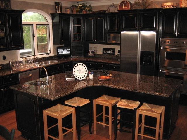 Handpained and distressed black kitchen cabinetry...