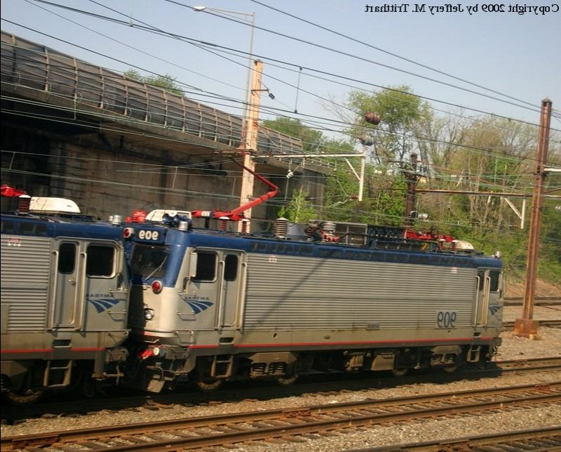 Amtrak AEM7 No. 909 leads Amtrak Regional, 178, out of Union...