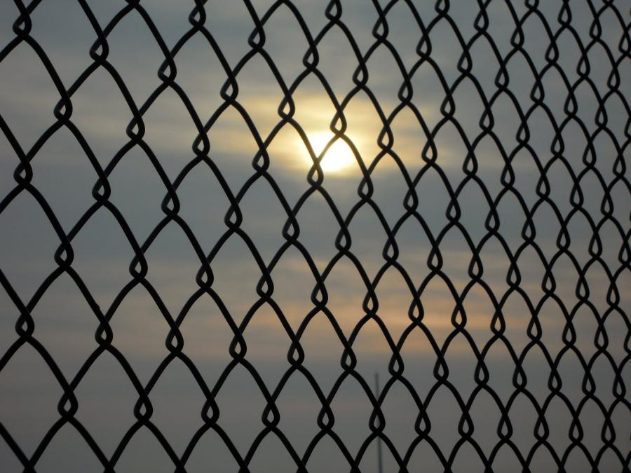 Sunrise through a Chain Link Fence