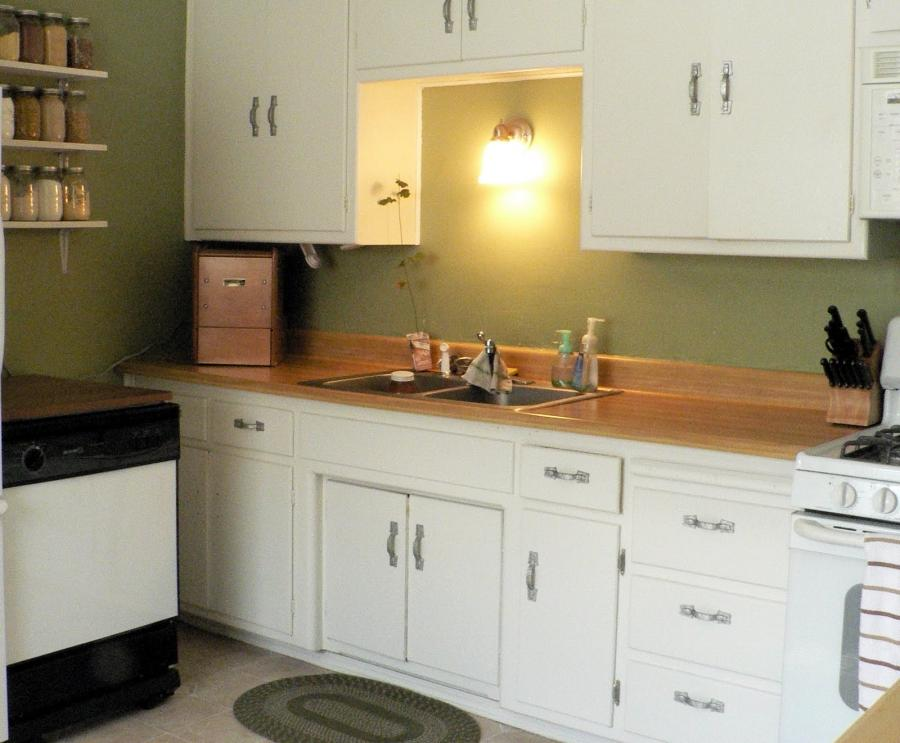 White cabinets green walls photo for What kind of paint to use on kitchen cabinets for decorative metal art for walls