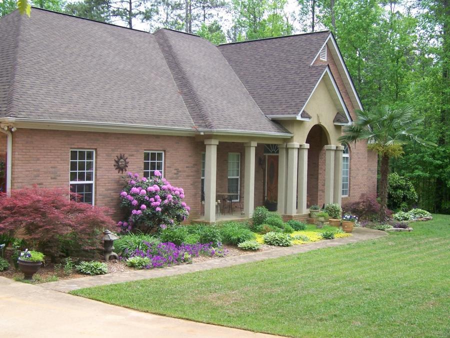 Photos of brick and stucco homes for Stucco and brick homes