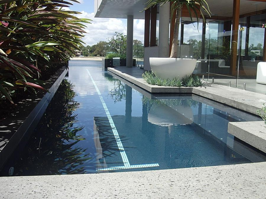 Amazing photos of houses in lap of nature for Lap pool designs for home