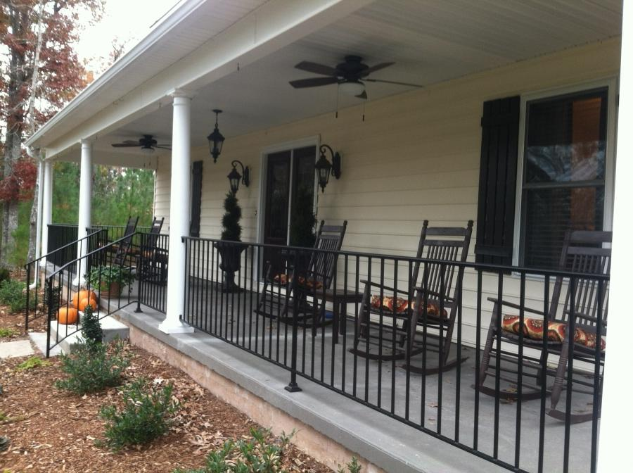 Added wrought iron railing, front porch fans, and new lights:
