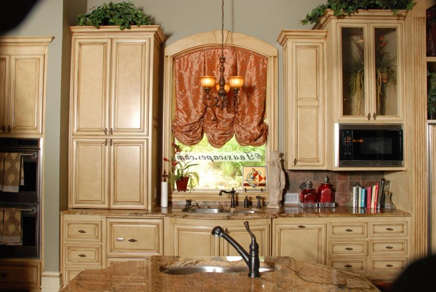 Faux finished antiqued kitchen cabinets in Baton Rouge!