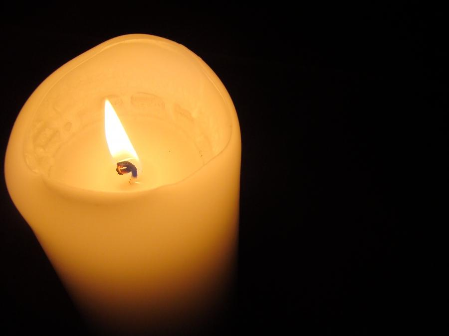 The candle has formed a bowl shape from burning, which prevents...