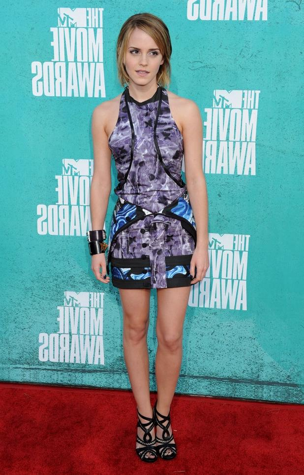 Previous Next Emma Watson on the red carpet at the MTV Movie...