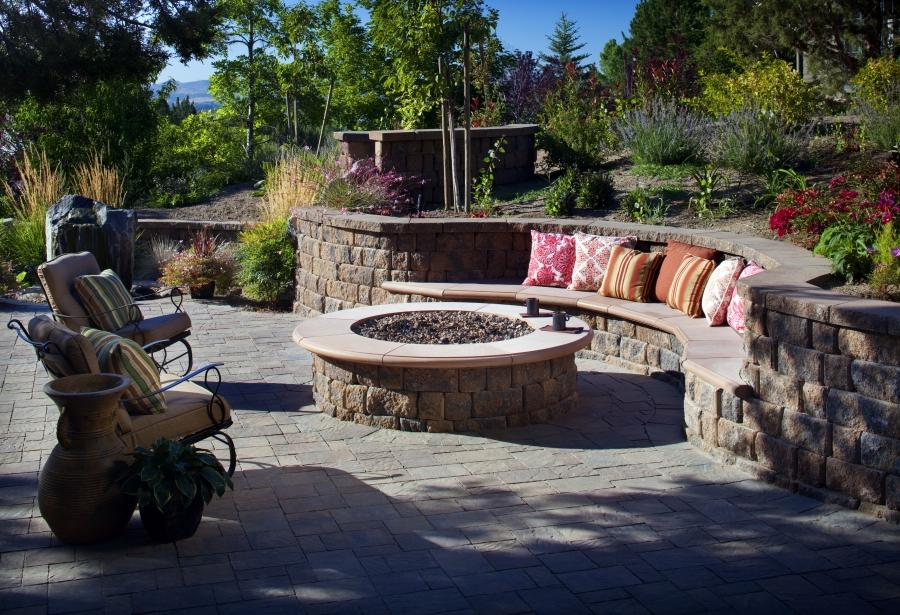 ... idea of outdoor firepit with round details having curvy stone...