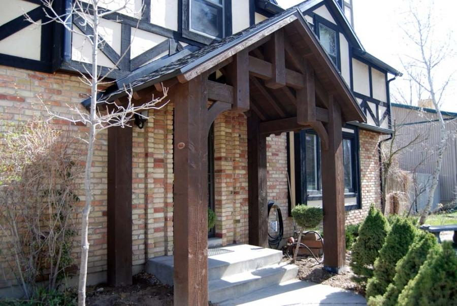 Timber Entryways: A roofed area usually involving a truss in the...
