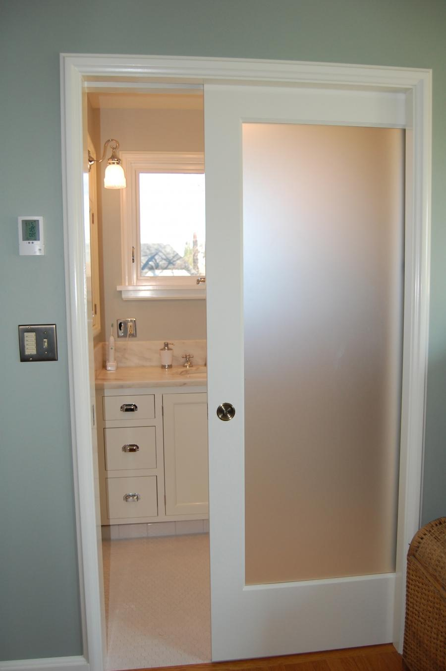 Show me photos of pocket doors for bathrooms for Small bathroom entry door ideas