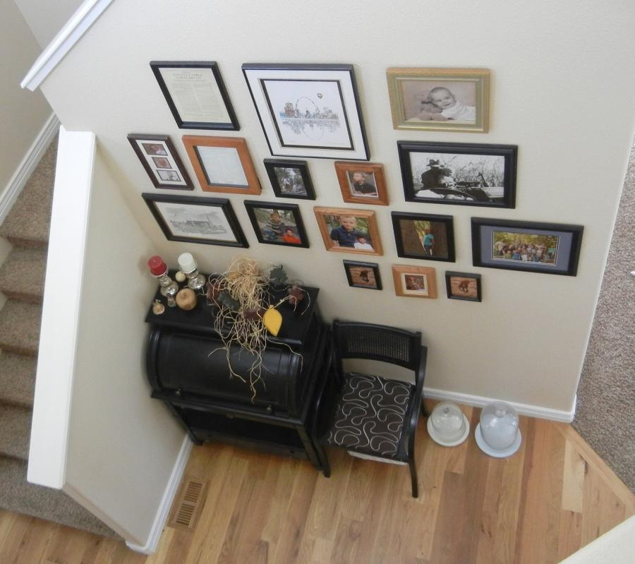 versatile hallway with chic hanging family photo with comfy chair...