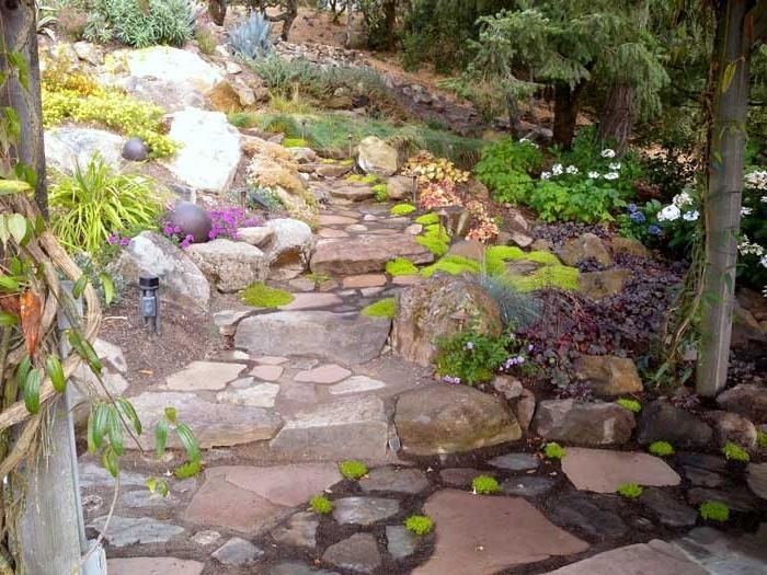 Rock gardens on slopes uncluttered rock garden on a for Sloped rock garden designs