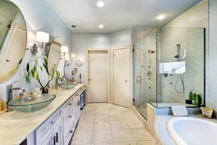 Brushed nickel bath fixtures, upgraded mirror with matching...