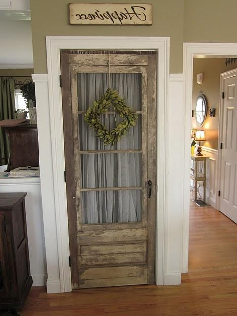 Simply remove the newer door and replace with an old, salvaged...
