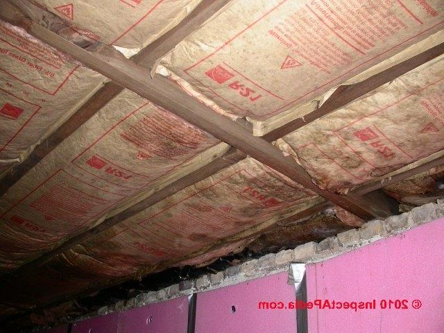 Basement ceiling insulation with vapor barrier facing down (C)...