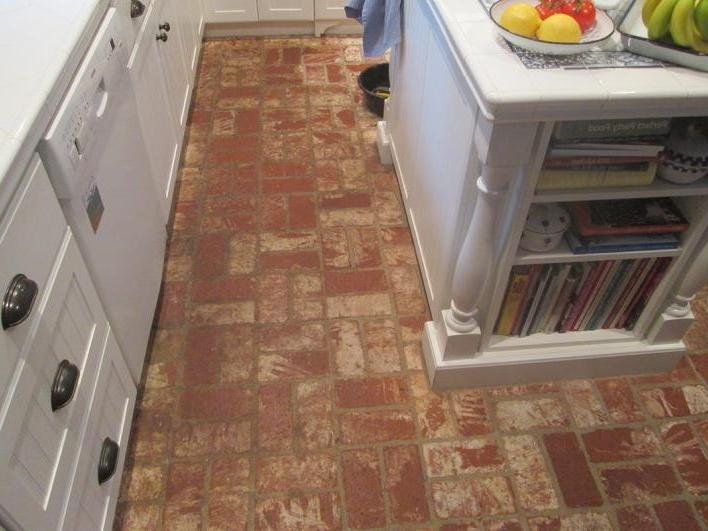 BEFORE PICTURE OF A BRICK KITCHEN FLOOR THAT NEEDED SOME...
