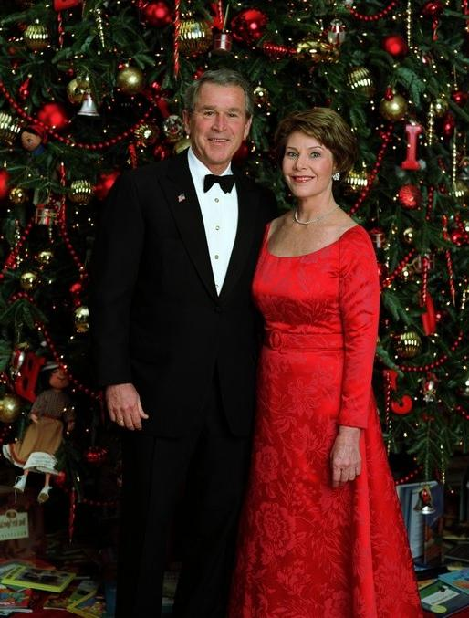 Celebrating the 2003 holiday season, President George W. Bush and...