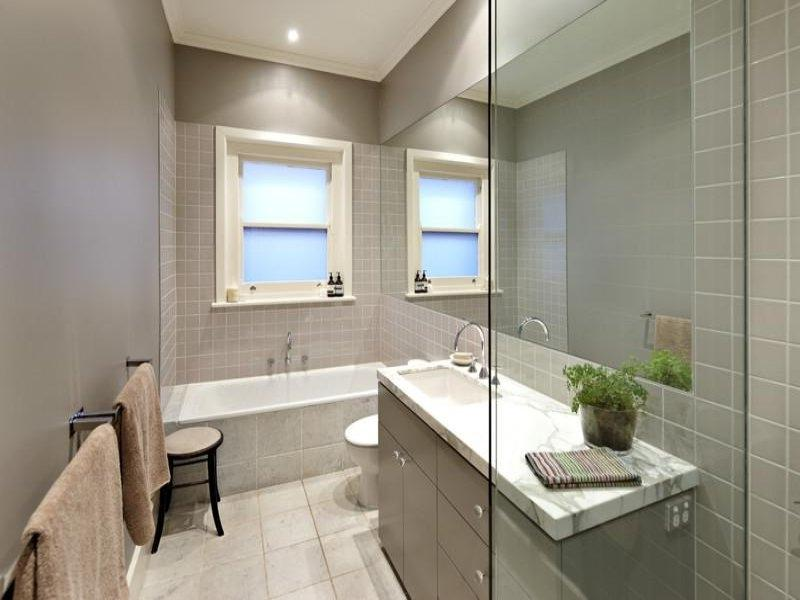Modern bathroom design with recessed bath using frameless glass -...