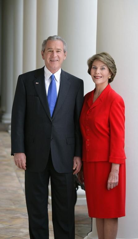 President George W. Bush and Mrs. Laura Bush pose for their...