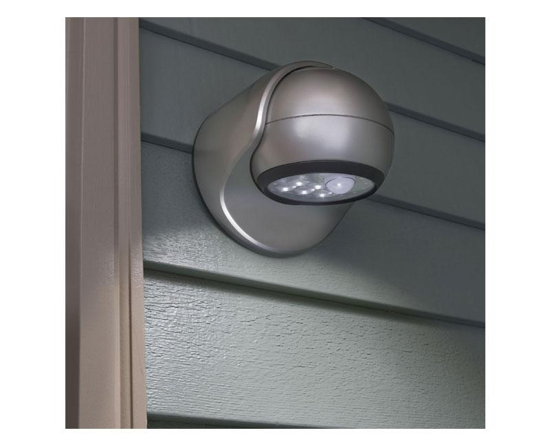 Motion-sensor LED porch light with adjustable, rotating head.
