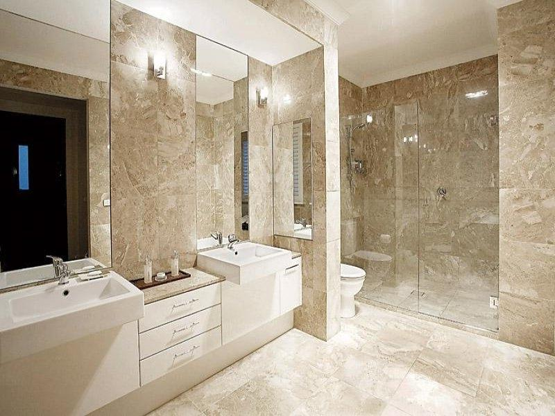 Modern bathroom design with twin basins using frameless glass -...