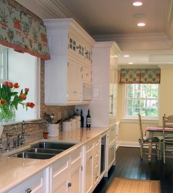 White Kitchen Dark Floors Colorful Window Treatment