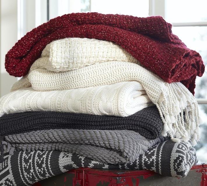 Warm cozy blankets are the best this time of year! These knit...
